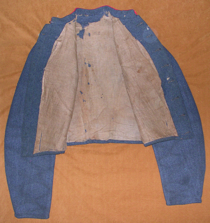 FIG 6: The inside lining is unbleached linen, has a single pocket in the left lapel, and bears a size stamp.  Images courtesy of History Colorado, Francis Marion Durham Collection, Photo. #2005.52.3.v3.