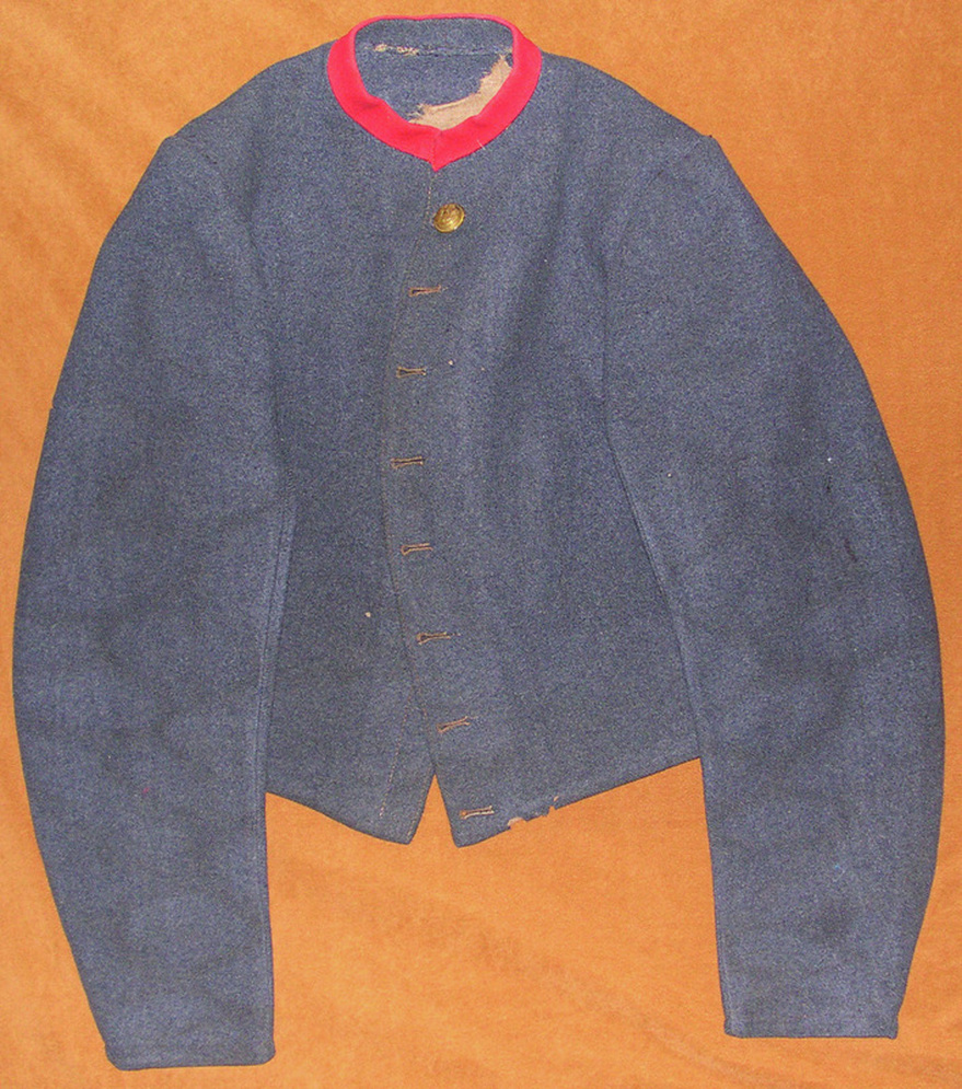 FIG 4: The front of the Durham jacket exhibits eight, keyhole buttons and the blue-gray kersey typical of all Tait jackets.  Images courtesy of History Colorado, Francis Marion Durham Collection, Photo. #2005.52.3.v1.